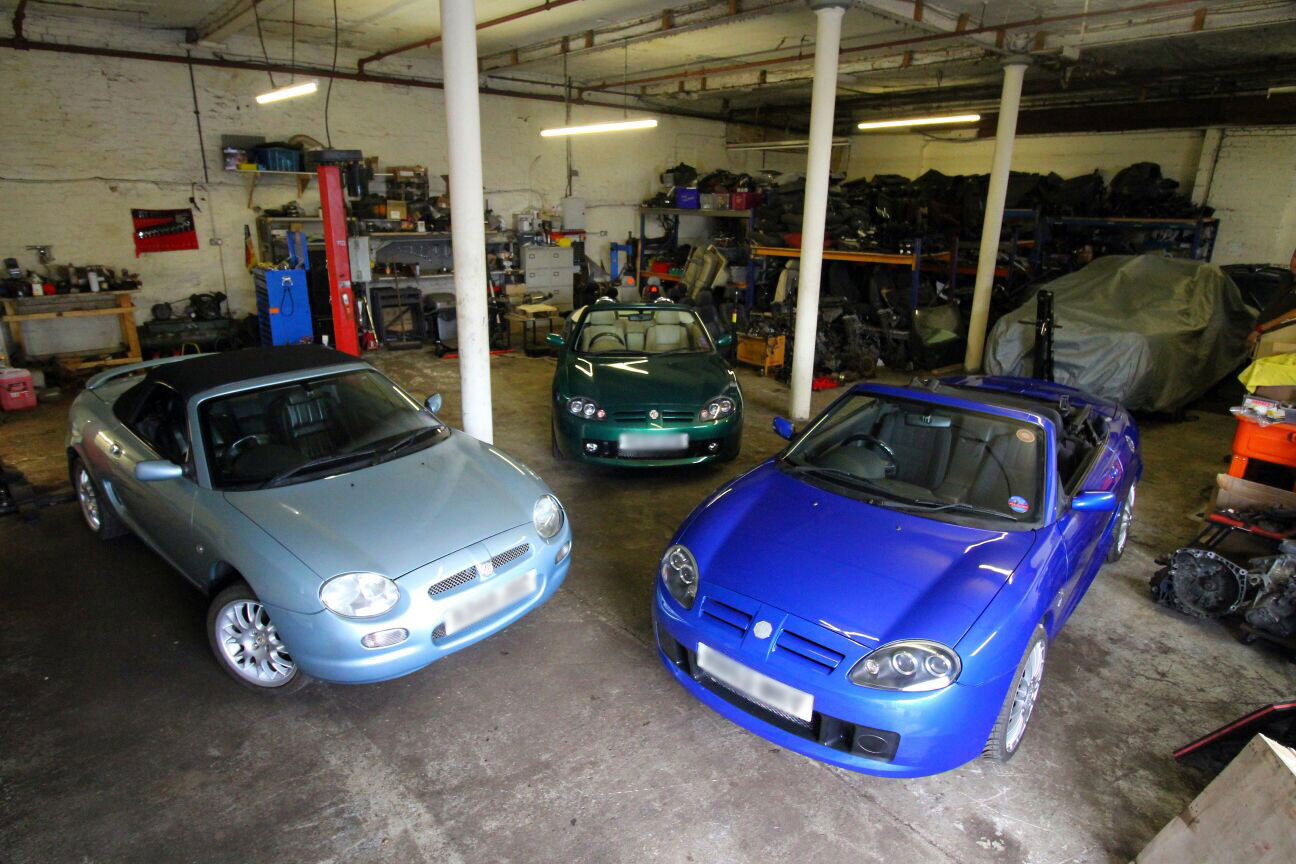 Photograph of cars in the MG and Alfa Workshop