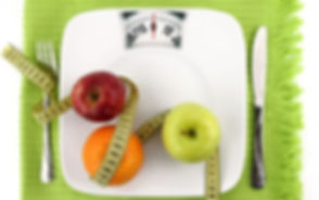 Fruits-with-measuring-tape-on-a-plate-li