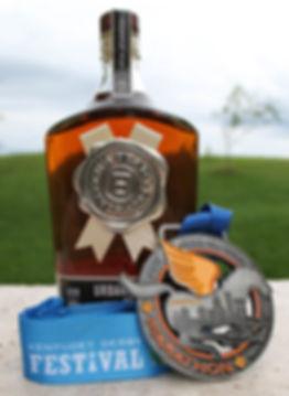 Kentucky Derby Festival Marathon medal and Jim Beam bottle