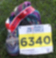 Running shoes, Navy Air Force Half Marathon medal and race bib