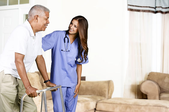 Health care worker helping an elderly ma