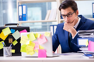 Businessman with reminder notes in multi