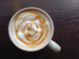 top view of caramel latte in coffee cup
