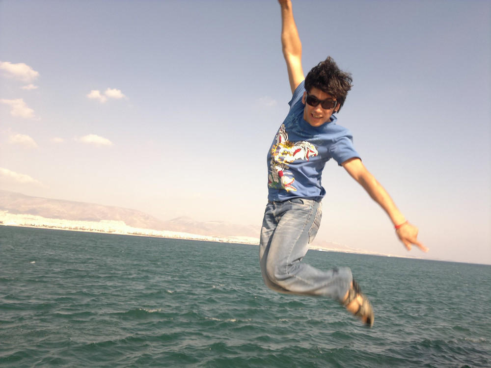Abduol jumping near the Greek coast. Photo courtesy of Abduol Nazari.