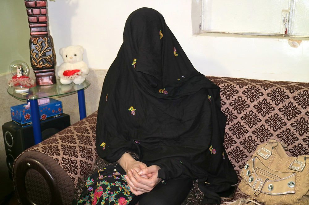 Gulalai, 25, a transgender Afghan living in Pakistan, covers her face to protect her identity. (Photo by Umer Ali)