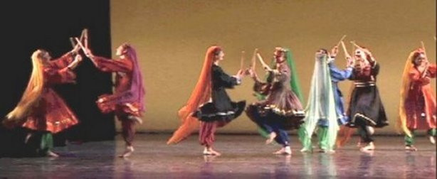 Women performing Chopbazi. Photo by EasternArtists.com.