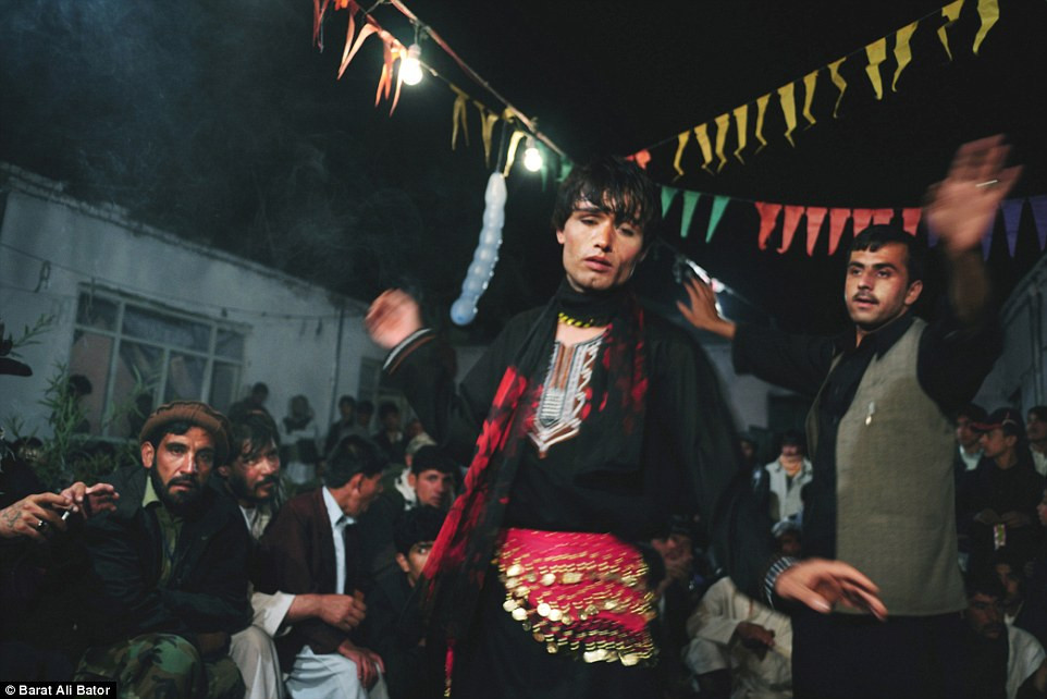 Shukur, 21 in this picture, was kidnapped in Kabul when he was 12 years old and taken to Kunduz where he was kept as a Bacha Bereesh - a dancing boy - for a rich and powerful man. He was 17 when he escaped, and began making a living from his dancing. Photo by Barat Ali Bator via DailyMail.co.uk.
