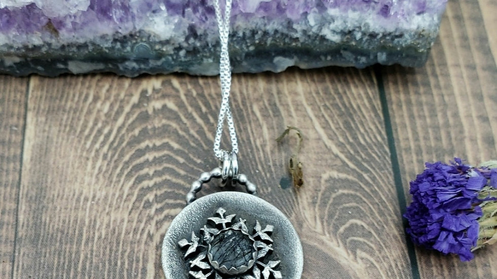 Rutilated black quartz snowflake pendant