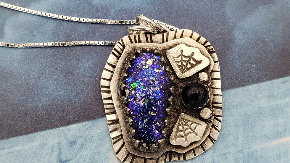 Resin coffin pendant with black onyx gemstone