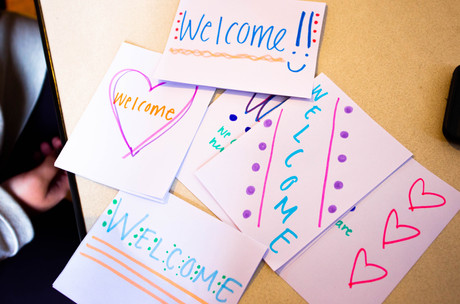 Students organize welcome packages for refugees arriving to New York State.