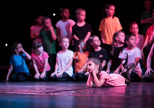 Children performing on stage