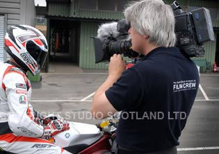 Cameraman filming rider Nial MacKenzie on his motorbike