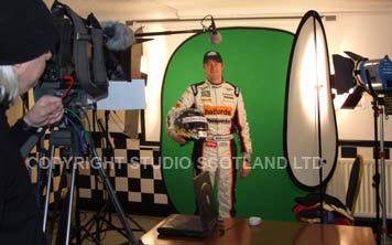 Filming set with F350, boom mic, car racing driver and greenscreen background