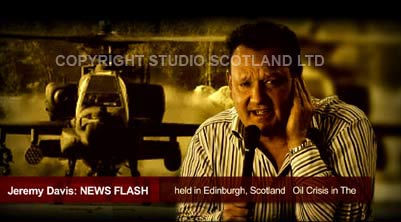 Footage still: Jeremy Hitchen as news reporter with greenscreened Apache helicopter in background