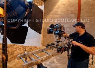Studio 2k light with camera on ladder dolly