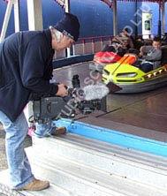 low shooting camera work of children on dogems / bumper car ride