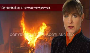 footage still showing presenter and green-screen fire scene background