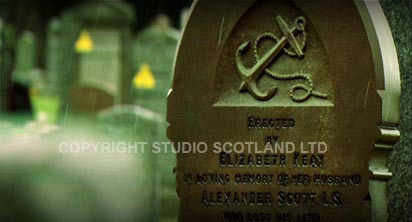 Footage still: Designed for Destruction - showing cemetary naval headstone