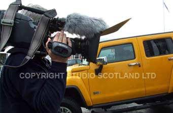 shouldermounted camera and yellow Hummer