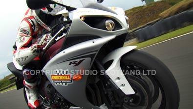 Closeup of Niall Mackenzie on his R1 superbike