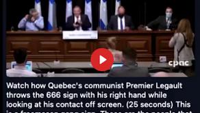 Quebec Premier Makes 666 Sign