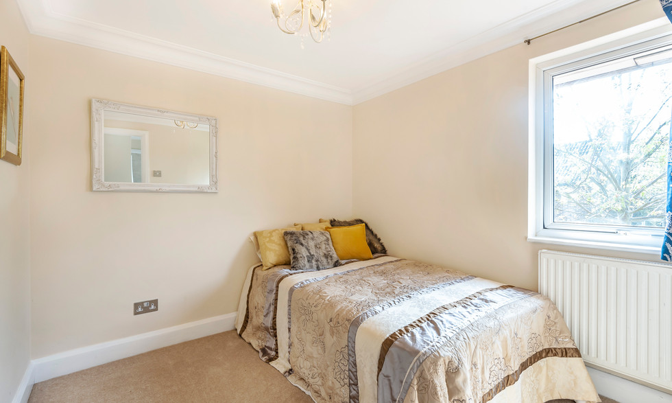 one of 3 large bedrooms