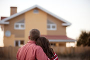 Two new homeowners admiring their home