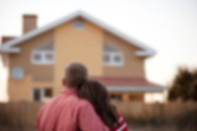 Couple admiring their home