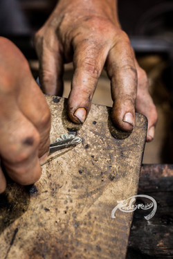 the hands of a silversmith