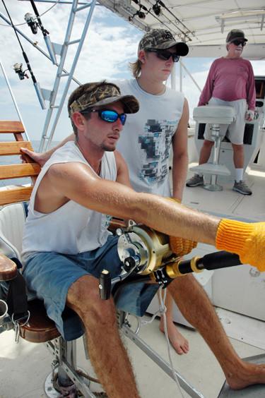 angler reeling in swordfish