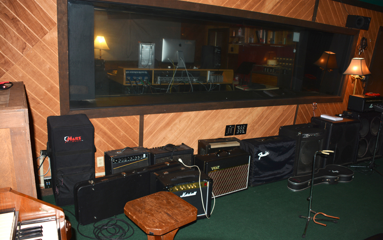 Amps line wall in FAME Studio B - OR
