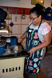 OR-Rosyy Pulido cooks turkey breasts at Rancho Mababi