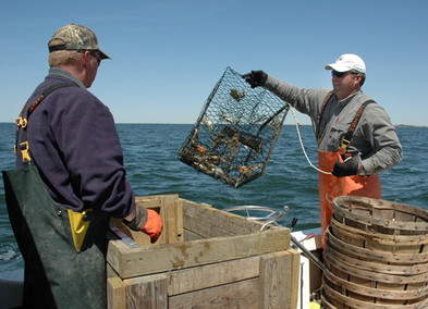 OR-Charles Laird swings aboard a crab pot