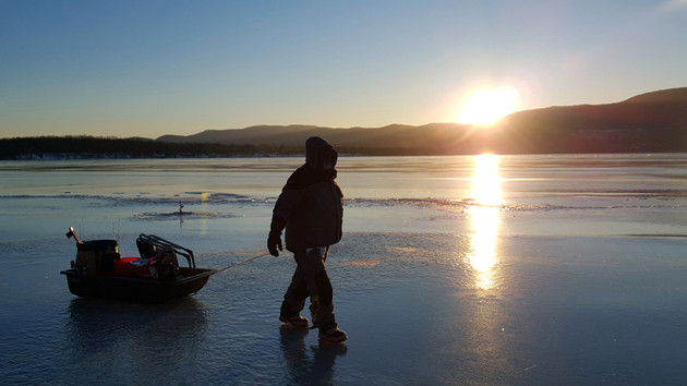 'Come to the light' – Ice Fishing: the Cold, Windy and Surreal on Lake Champlain