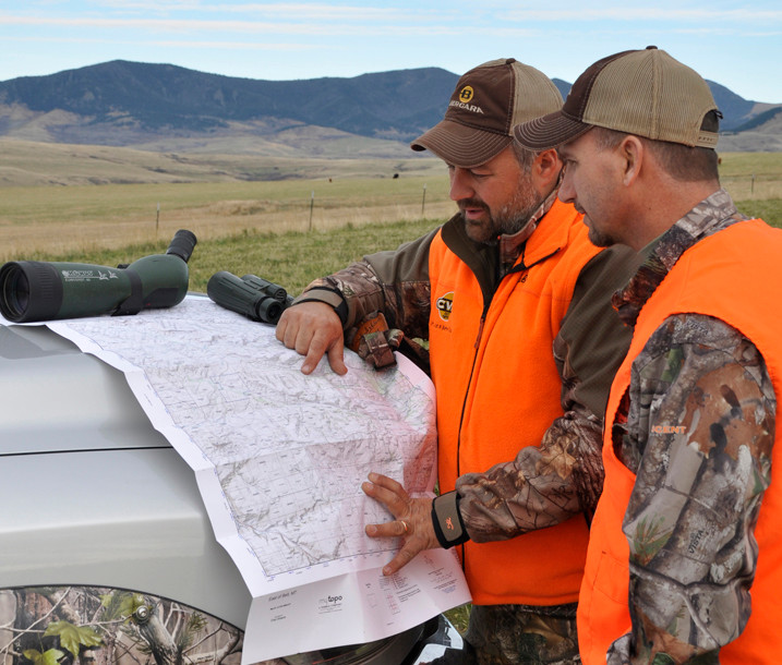 Chad Schearer and Dan Hanus use a MyTopo map in Montana