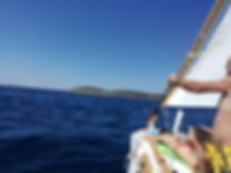 traditional sailing with woden boat gajeta on latin sail