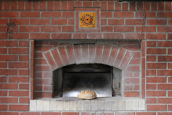 Freshly baked bread in front of the Brickery oven.