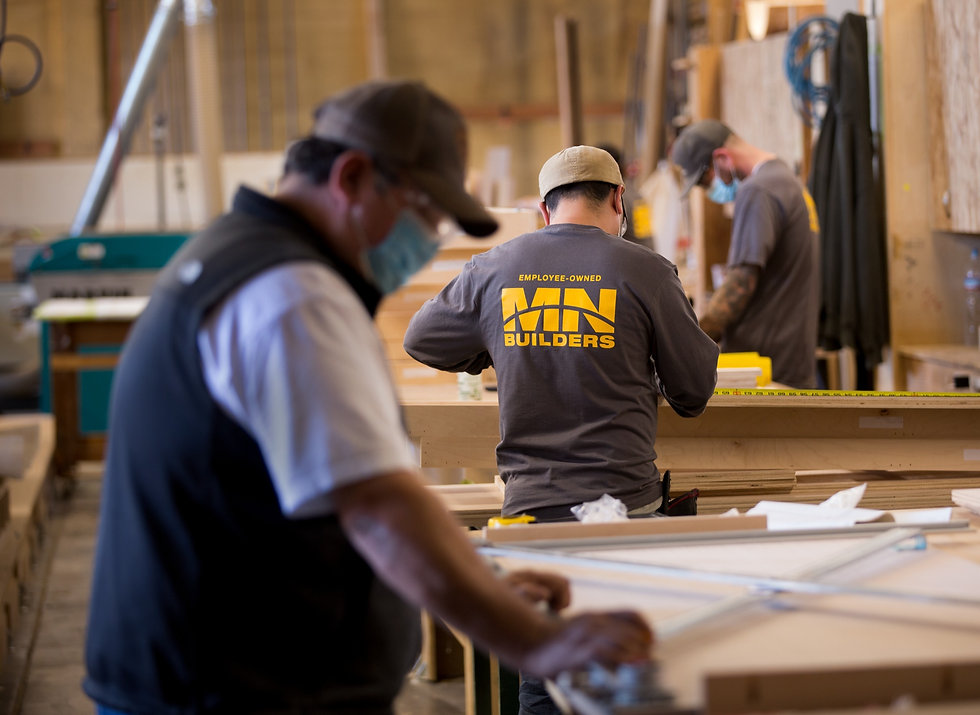 Craftsmen of MN Builders, an Employee-Owned, Oakland company, working in millwork shop.