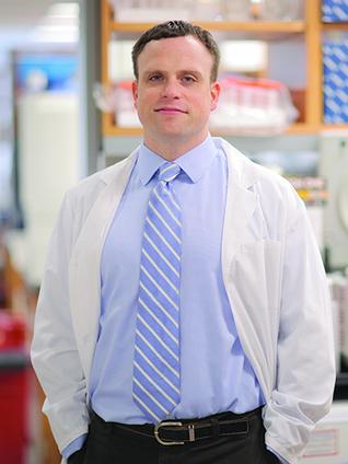 Dr. Christopher E. Mason