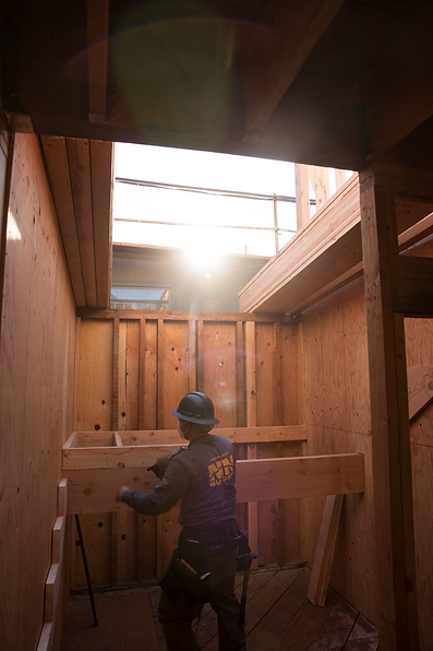 MN Builders worker framing out house.