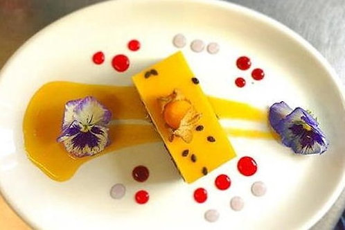 Passion fruit and white chocolate delice with dark chocolate sorbet.