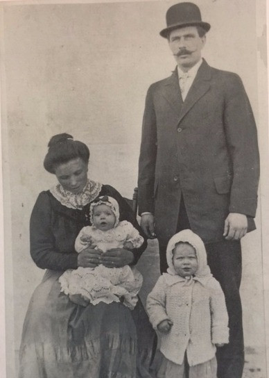 My great-grandpa with my great-grandma and their first two children