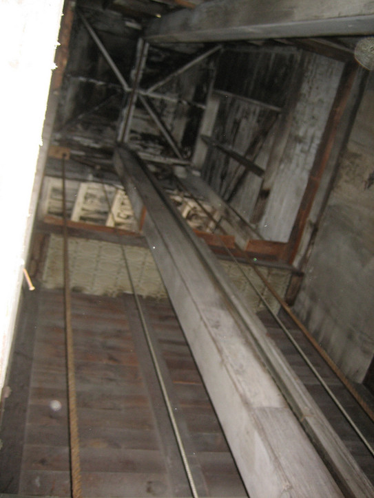 View up the elevator shaft. The thick rope on the left was the used to hoist and lower the elevator - no powered units back then! (I imagine that it probably required more than one person to raise or lower the elevator when a significant ly sized granite slab was loaded onto it!)