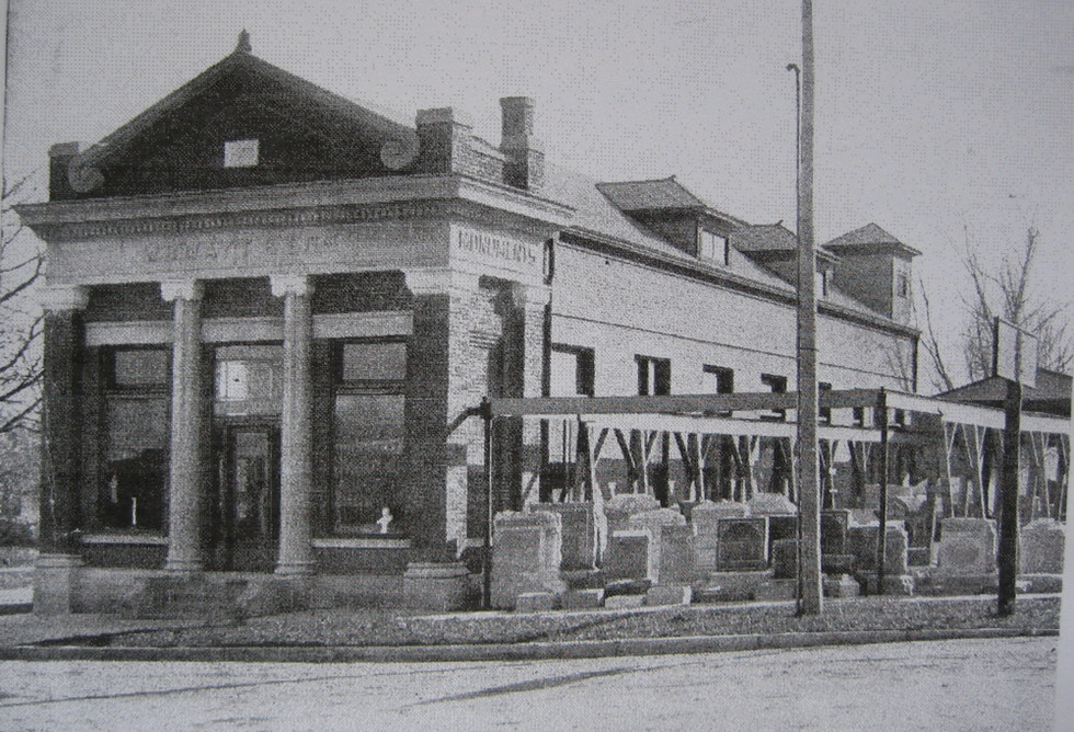 Photo of the 'new' monument company building as it was nearing completion in 1913. Note the trellis structure over the monuments. This was used to hoist and lower the finished monuments in and out of the working areas inside the building.