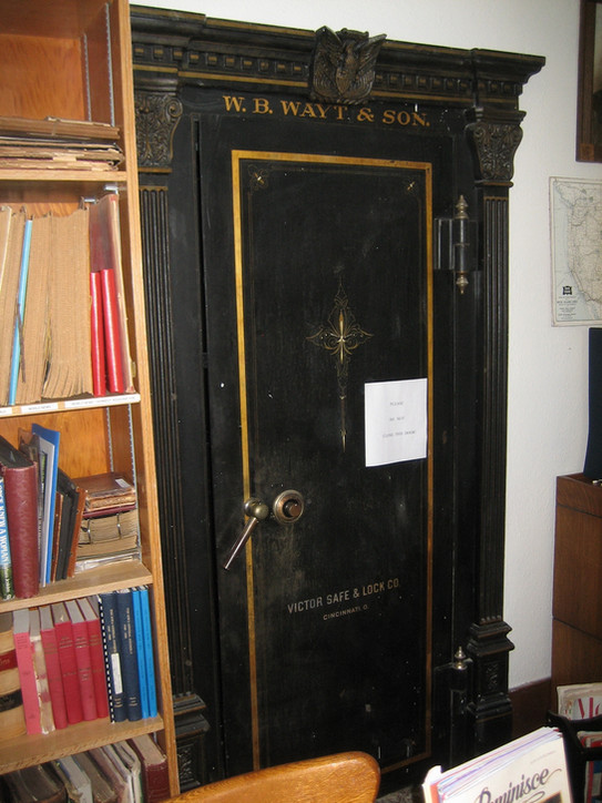 Original safe inside the office. Note the name painted at the top and the wonderful wood trim.