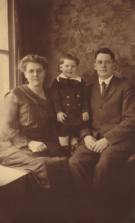 Lonnie and Bertha Wayt Winters with son Howard.  Marshall Avenue, Elm Grove, West Virginia ~1920.