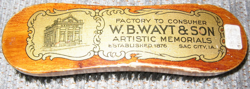 Horse brush with company advertisement, probably used as a promotional device.