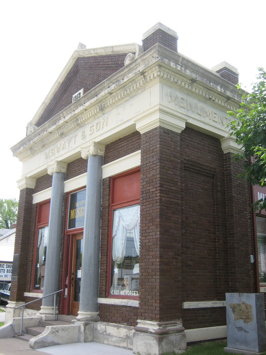Side view of the monument company building showing 'Monuments.' It was exciting to see the company logo with the Wayt family name on a building that was built so long ago (completed in 1913).