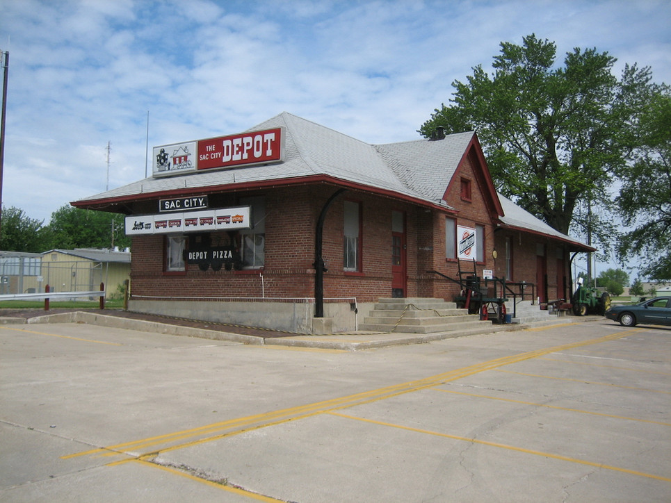 The old Sac City train depot, across Main street from the W.B. Wayt Monument Company. Both the Milwaukee Railroad and the Northwestern Railroad came into Sac City back in those days. Interestingly, even though it is now a pizza place, it has kept the name 'The Depot.'