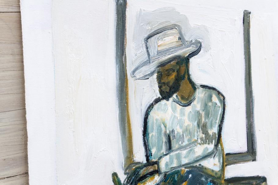 Handsome Man In Hat (Sitting On Trunk) detail